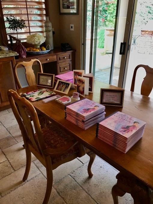 Preparing the signing table for the Coffee with Girlfriends event.